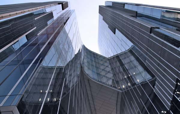 a business complex, blue buildings with concentric lines towards the sky, a world trade center